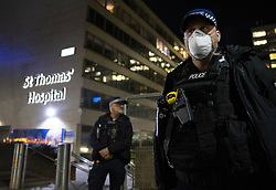 © Licensed to London News Pictures. 06/04/2020. London, UK. Police stand guard outside St Thomas' Hospital in central London where British Prime Minster Boris Johnson, who has contracted COVID-19, has been admitted to the intensive care unit after his conditioned worsened. The United Kingdom has started a third week of lockdown in an attempt to halt the spread of the coronavirus Covid-19. Photo credit: Peter Macdiarmid/LNP