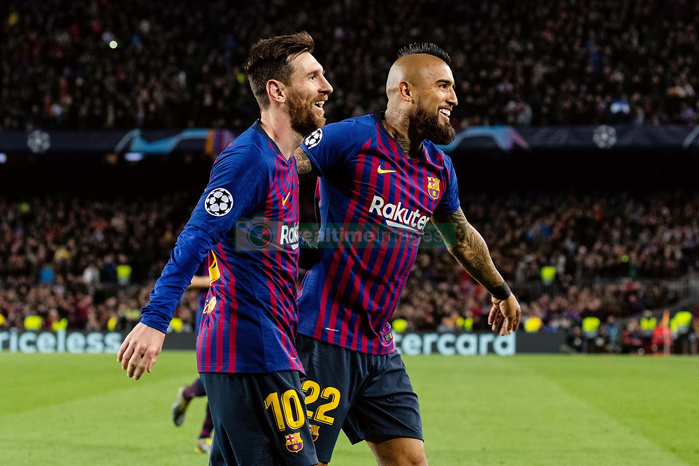BARCELONA, March 14, 2019  Barcelona's Lionel Messi (L) and Arturo Vidal celebrate a goal by teammate Gerard Pique during the UEFA Champions League match between Spanish team FC Barcelona and French team Lyon in Barcelona, Spain, on March 13, 2019. Barcelona won 5-1 and advanced to the quarterfinals. (Credit Image: © Joan Gosa/Xinhua via ZUMA Wire)
