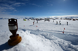 "© Licensed to London News Pictures. Union Glacier, Antarctica. An Ashes replica model is in foreground. Competitors from the Antarctic Ice Marathon play a game of impromptu ""Ashes"" cricket at the Union Glacier camp, Antarctica ahead of the 2013 Antarctic Ice Marathon, which takes place  just a few hundred miles from the South Pole at the foot of the Ellsworth Mountains.. The majority of players were either Australian and English. It was declared a sporting draw. Photo credit: Mike King/LNP"