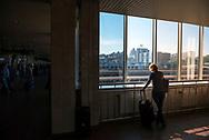 A female passenger makes a phone call inside the main train station in Kiev, Ukraine.
