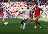 Leeds United FC midfielder Tom Adeyemi  passes the ball shadowed by Middlesbrough FC striker David Nugent during the Sky Bet Championship match between Middlesbrough and Leeds United at the Riverside Stadium, Middlesbrough, England on 27 September 2015. Photo by George Ledger.