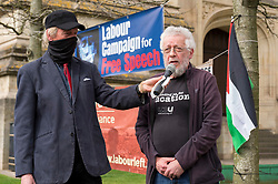 © Licensed to London News Pictures;31/03/2021; Bristol, UK. Academic Dr. RON MENDEL speaks at a coalition of Labour Left organisations including Labour Campaign for Free Speech and speakers hold a lobby in defence of academic freedom and Professor David Miller outside Bristol University. Around 50 protesters assembled at 2pm outside the Wills Memorial Building to express solidarity and support for Professor Miller who has been suspended by the University of Bristol over allegations of anti-semitism. Speakers included Dr. Eldin Fahmy, Senior Lecturer of Policy Studies at University of Bristol, Sandy Kennedy, a former graduate from Bristol University, who has worked in an Israeli Kibbutz, and there were messages of support from Roger Waters, Alexei Sayle, Chris Williamson MP, Ken Loach, and Jonathan Cook. Photo credit: Simon Chapman/LNP.