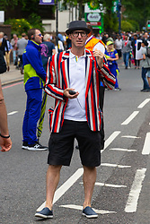 A man is wearing a London New Zealand Cricket Club Blazer as crowds flock to Lords Cricket Ground, the Home of Cricket to watch the ICC Cricket World Cup final between England and New Zealand. London, July 14 2019.