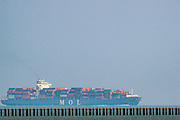 A general picture shows cargo ships filled with goods waiting for the tide of the sea to rise and dock to unload as local residents of Eastern England were enjoying the sunshine in East Beach of Shoeburyness on Monday, July 26, 2021 - following the weekend of Floods due to torrential rains in England, United Kingdom. (VX Photo/ Vudi Xhymshiti)