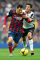 BARCELONA, SPAIN - FEBRUARY 01:  Lionel Messi of FC Barcelona competes for the ball with Dani Parejo (R) of Valencia CF during the La Liga match between FC Barcelona and Valencia CF at Camp Nou on February 1, 2014 in Barcelona, Spain.  (Photo by Manuel Queimadelos Alonso/Getty Images)