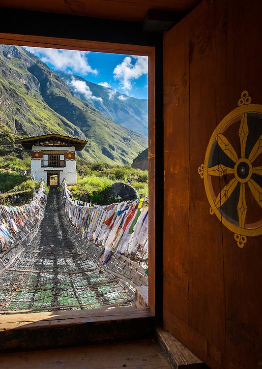 PARO, BHUTAN - CIRCA October 2014: Iron Chain Bridge and Tachog Lhakhang Dzong