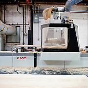Wood cutting machine in factory