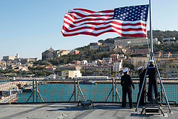 March 23, 2019 - Gaeta, Italy - Sailors aboard the Blue Ridge-class command and control ship USS Mount Whitney (LCC 20) shift colors as the ship moors pierside, March 23, 2019.  Mount Whitney, forward deployed to Gaeta, Italy, operates with a combined crew of U.S. Navy Sailors and Military Sealift Command civil service mariners. (Credit Image: © U.S. Navy/ZUMA Wire/ZUMAPRESS.com)