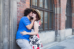 Young couple kissing outdoors in city