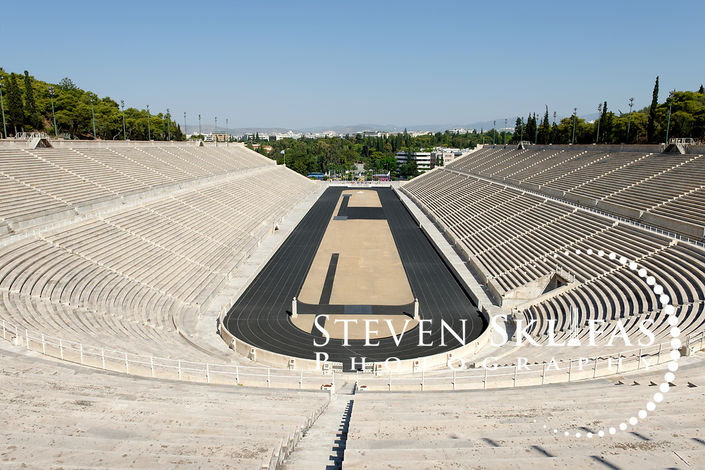 Athens. Greece. View of the Panathenaic stadium and its horse shaped shoe running track. The Panathenaic (Kallimarmaro) stadium was used for the first international Olympic games of the modern era in 1896.  The completely marble stadium occupies the exact site of the original, built in 330BC which was used for the ancient Panathenaic games (part of the larger religious festival, the Panathenaia).