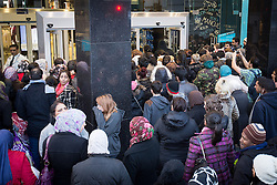 © Licensed to London News Pictures . 26/12/2013 . Manchester , UK . Shoppers queue outside Primark in Manchester City Centre . Thousands of shoppers queue for hours in freezing temperatures in Manchester this Boxing Day morning (26th December 2013) in order to be amongst the first to purchase reduced price products in shops' sales . Photo credit : Joel Goodman/LNP