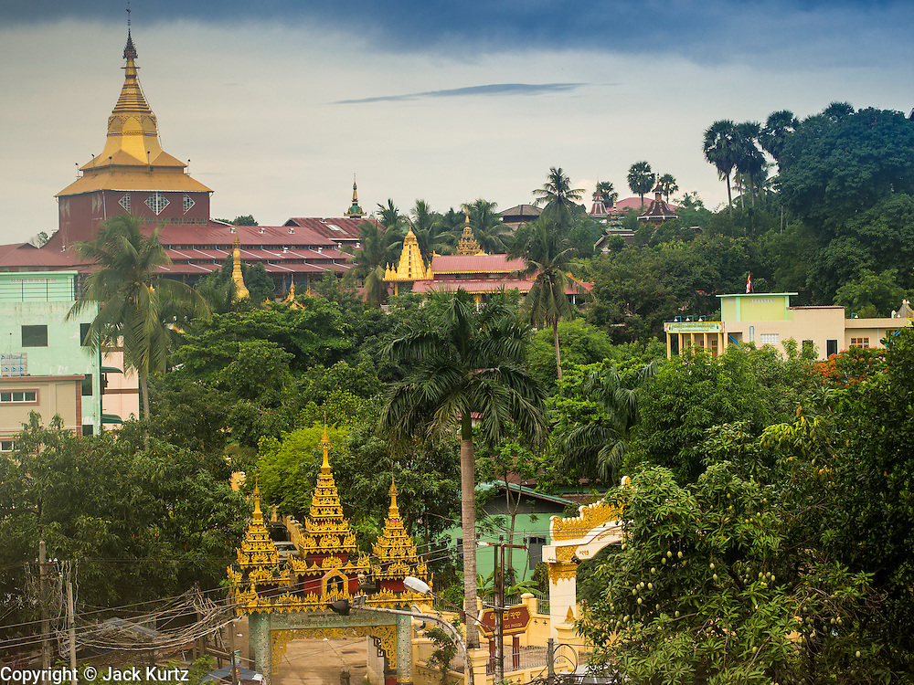 05 JUNE 2014 - YANGON, YANGON REGION, MYANMAR:  The roofline of Ngahtatgyi Paya (Pagoda) a Buddhist temple across the street from Chauktatgyi Paya in Yangon, Myanmar. Yangon, with a population of over five million, continues to be the country's largest city and the most important commercial center.    PHOTO BY JACK KURTZ