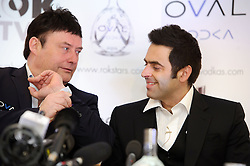 © Licensed to London News Pictures. 26/02/2013 London, UK. Reigning world snooker champion Ronnie O'Sullivan (right) announces his return to snooker with Jimmy White at The London Hilton Metropole Hotel. The 37 year old pulled out of the 2012-13 season due to 'personal reasons' after playing just one match. He plans to defend his title with his first match at The Crucible, Sheffield in April this year..Photo credit : Simon Jacobs/LNP