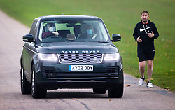 © Licensed to London News Pictures. 31/10/2020. Windsor, UK. Prince Andrew, Duke of York, passes a jogger as he drives near Windsor Castle. Photo credit: Peter Macdiarmid/LNP