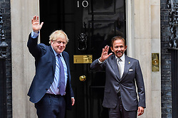 Licensed to London News Pictures. 04/02/2020. LONDON, UK.  Hassanal Bolkiah, the Sultan of Brunei, (R) and Boris Johnson, Prime Minister, (L) wave to the media ahead of talks in Number 10 Downing Street.  Photo credit: Stephen Chung/LNP