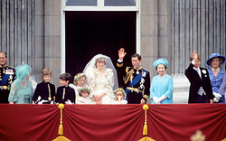 Princess Diana stands on the balcony on her wedding day as Prince Charles waves to the crowd and other family members look on