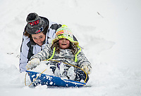 """Sliding hill at Memorial Field in Laconia on a """"snow day"""".  Karen Bobotas photo/ for the Laconia Daily Sun"""