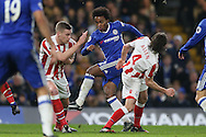 Willian of Chelsea (c) shoots to score his sides 2nd goal. Premier league match, Chelsea v Stoke city at Stamford Bridge in London on Saturday 31st December 2016.<br /> pic by John Patrick Fletcher, Andrew Orchard sports photography.