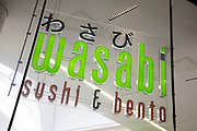 Sign for the sushi and bento restaurant brand Wasabi in Birmingham, United Kingdom.