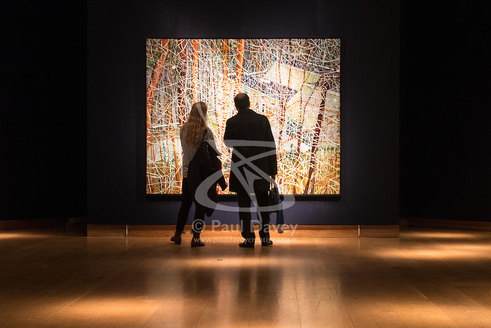 Christies, St James, London, February 5th 2016. A man and a woman admire Peter Doig's masterpiece The Architect's Home In The Ravine, which is expected to fetch between £10-15 million at auction, during the 20th Century Art Sale Preview. ///FOR LICENCING CONTACT: paul@pauldaveycreative.co.uk TEL:+44 (0) 7966 016 296 or +44 (0) 20 8969 6875. ©2015 Paul R Davey. All rights reserved.