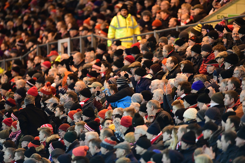 Lincoln City fans watch their team in action<br /> <br /> Photographer Chris Vaughan/CameraSport<br /> <br /> The EFL Sky Bet League Two - Lincoln City v Cheltenham Town - Tuesday 13th February 2018 - Sincil Bank - Lincoln<br /> <br /> World Copyright © 2018 CameraSport. All rights reserved. 43 Linden Ave. Countesthorpe. Leicester. England. LE8 5PG - Tel: +44 (0) 116 277 4147 - admin@camerasport.com - www.camerasport.com