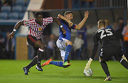 Carlisle United's Richard Bennett is tackled by Sunderland's Lamine Kone (left)