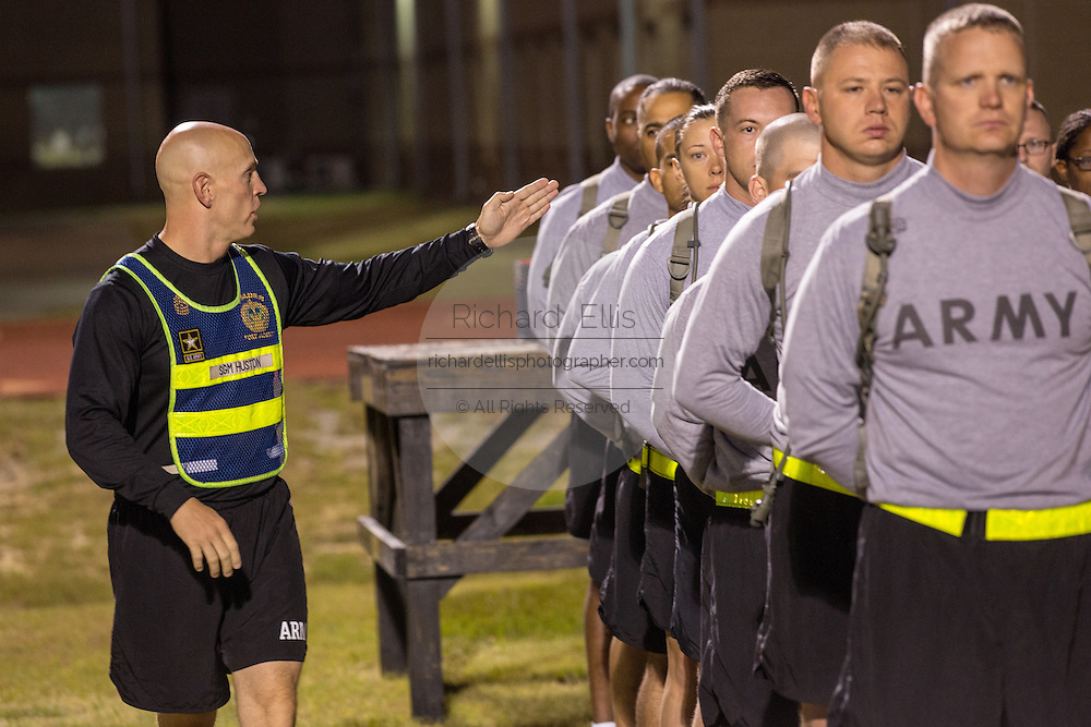 Sergeant Major Blaine J. Huston yells instructions to Drill  Sergeant candidates at the US Army Drill Instructors School Fort Jackson line up before taking their physical training test early morning September 27, 2013 in Columbia, SC. While 14 percent of the Army is women soldiers there is a shortage of female Drill Sergeants.