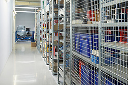 Interiors of warehouse with goods on shelves, Munich, Bavaria, Germany