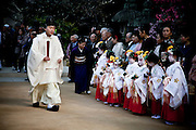 KYOTO, JAPAN - Japanese wedding Ceremony at the Kitano Tenmangu shrine, the young bridesmaid wear the  Heian period kimono style -March 2011