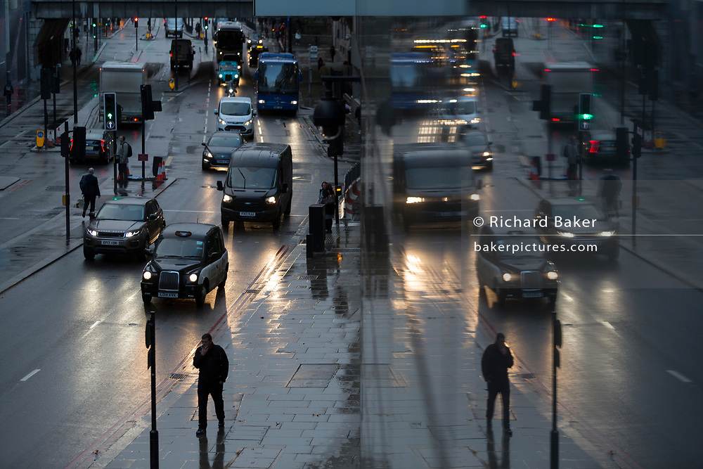 Pedestrians and traffic on Upper Thames Street in the City of London, the capital's financial district - aka the Square Mile, on 7th November 2018, in London, England.