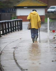 © Licensed to London News Pictures. 25/11/2012..North East England..A man walks along the side of a flooded small gauge railway line in Saltburn in Cleveland after heavy overnight rain caused traffic disruption and flooding in parts of Cleveland and North Yorkshire...Photo credit : Ian Forsyth/LNP