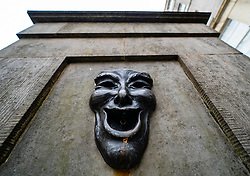 Theatrical mask bronze relief with happy face on High Street Wellhead on the Royal Mile in Edinburgh, Scotland, UK