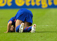 Photo: Daniel Hambury.<br />Ajax v Manchester United. Amsterdam Tournament. <br />05/08/2006.<br />Manchester's Michael Carrick winces with pain after the challange that left him unable to continue the match.
