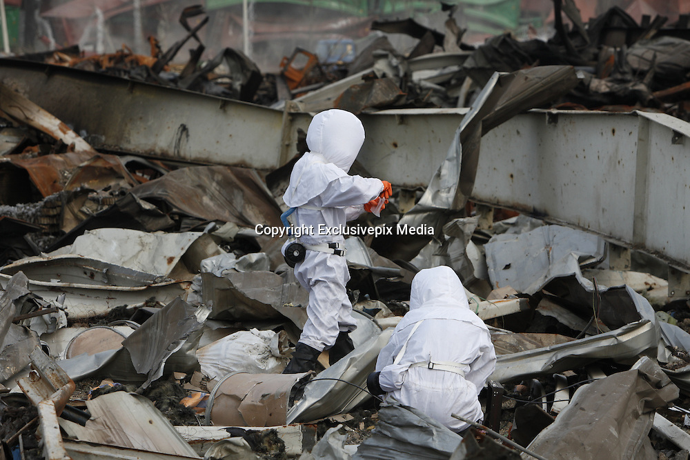 TIANJIN, CHINA - AUGUST 24: (CHINA OUT) <br /> <br /> Chemical-defence Soldiers Detect Toxic Substance<br /> <br /> Soldiers of a PLA chemical-defence unit detect toxic substance at Tianjin blasts scene on August 24, 2015 in Tianjin, China. The death toll from the Tianjin warehouse explosions two weeks ago has risen to 139, and 34 others remain missing, rescue authorities said on Wednesday. <br /> ©Exclusivepix Media
