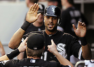 CHICAGO - JUNE 21:  Alex Rios #51 of the Chicago White Sox celebrates with teammates in the dugout after scoring a run in the third inning during the game against the Chicago Cubs on June 21, 2011 at U.S. Cellular Field in Chicago, Illinois.  (Photo by Ron Vesely)  Subject:  Alex Rios