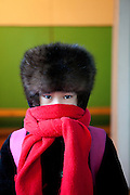 Yakutian girl at the school in Oymyakon prepared after her school hours to leave home with a warm fur cap and scarf. The area is extremely cold during the winter. Two towns by the highway, Tomtor and Oymyakon, both claim the coldest inhabited place on earth (often referred to as -71.2°C, but might be -67.7°C) outside of Antarctica. The average temperature in Oymyakon in January is -42°C (daily maximum) and -50°C (daily minimum). The images had been made during an outside temperature in between -50°C up to -55°C. Oymyakon, Oimjakon, Yakutia, Jakutien, Russian Federation, Russia, RUS, 20.01.2010