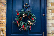 A Christmas wreath hangs on the front door of a residential house in London, England on December 20, 2018.