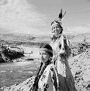 0001-F48-11. September 9, 1956.  Oregon Camera Club field trip.  Younger Indian woman in traditional dress is Miss Buster George, of Celilo Village.  Older Indian woman in traditional dress is Rachel Edmo, also of Celilo Village.  (she is the mother of Ed Edmo)