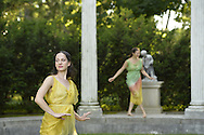 Old Westbury, New York, U.S. - June 21, 2014 - Dancers in colorful Greek tunics appear at the Colonnade when Lori Belilove & The Isadora Duncan Dance Company starts to dance throughout the gardens, at the Long Island Gold Coast estate of Old Westbury Gardens on the first day of summer, the summer solstice.