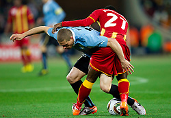 Diego Perez of Uruguay vs Kwadwo Asamoah of Ghana during to the 2010 FIFA World Cup South Africa Quarter Finals football match between Uruguay and Ghana on July 02, 2010 at Soccer City Stadium in Sowetto, suburb of Johannesburg. (Photo by Vid Ponikvar / Sportida)