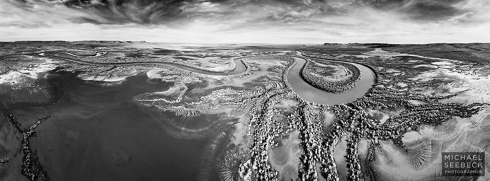 A beautiful mangrove-lined river winds its way over vast mudflats on its way to the sea.<br /> <br /> A 2.7:1 Panoramic Print, available in 40in (100cm) to 70in (178cm) sizes. Larger sizes available by special request. ('Image Size' below is not indicative of print size and resolution.)<br /> <br /> Limited Edition of 25 only.<br /> <br /> Code: AAWK0001
