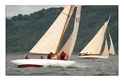 Sunshine, a 6 metre built in 1929, sailed by Helen Sandiford and an all girl crew, change headsails to windward of Tern a Gaff Cutter...This the largest gathering of classic yachts designed by William Fife returned to their birth place on the Clyde to participate in the 2nd Fife Regatta. 22 Yachts from around the world participated in the event which honoured the skills of Yacht Designer Wm Fife, and his yard in Fairlie, Scotland...FAO Picture Desk..Marc Turner / PFM Pictures