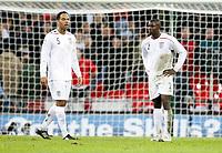 Photo: Richard Lane/Sportsbeat Images.<br />England v Croatia. UEFA European Championships Qualifying. 21/11/2007. <br />England's Jolean Lescott and Micah Richards show their dejection.