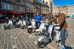 Edinburgh, Scotland, UK. 25 April 2021. Scenes from streets of Edinburgh city centre on Sunday afternoon on the day before non-essential shops and businesses can reopen in Scotland under relaxed covid-19 lockdown rules. Pic. Members of Edinburgh Central Scooter Club resting in Grassmarket during a Sunday afternoon ride.  Iain Masterton/Alamy Live News