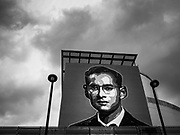 04 JULY 2017 - BANGKOK, THAILAND: Storm clouds over a portrait of Bhumibol Adulyadej, the Late King of Thailand, on the side of the Bangkok Art and Culture Centre in Bangkok, Thailand. The revered monarch died on Oct 13, 2016.  PHOTO BY JACK KURTZ