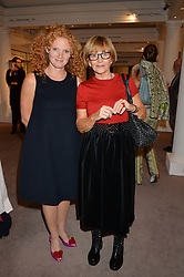 EMMA WILSON and her mother ANNE ROBINSON at a reception to celebrate the publication of Hockney - A Pilgrim's Progress by Christopher Simon Sykes held at Sotheby's, New Bond Street, London on 30th September 2014.