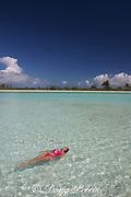 visitor relaxes in lagoon in front of Paris Beach, Christmas Island ( Kiritimati ), Republic of Kiribati, northern Line Islands, equatorial Central Pacific Ocean, MR 299