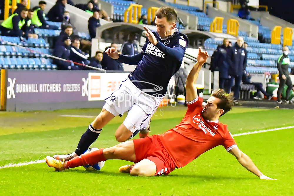 Millwall midfielder Jed Wallace (7)  Nottingham Forest Defender Yuri Ribeiro (5) battles for possession during the EFL Sky Bet Championship match between Millwall and Nottingham Forest at The Den, London, England on 19 December 2020.