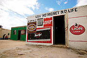Africa, Namibia 2004 - USA No Money, No Life. Bar in Namibia.
