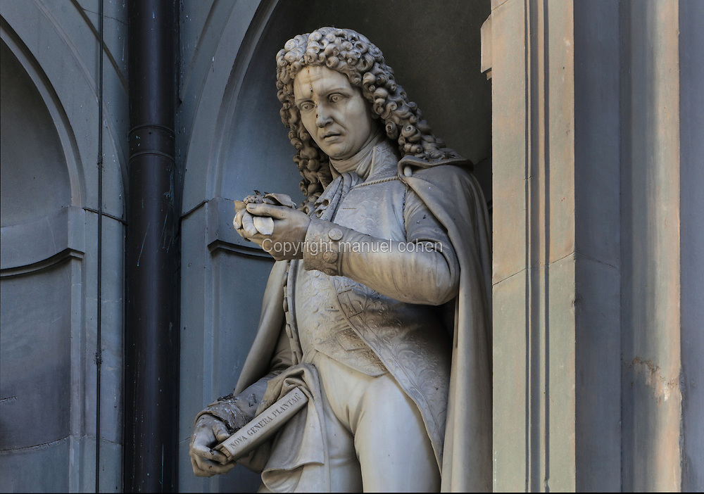 Statue of Pier Antonio Micheli, 1679-1737, Italian botanist, on the facade of the Galleria degli Uffizi, or Uffizi Gallery, an art museum adjacent to the Piazza della Signoria in Florence, Tuscany, Italy. The Uffizi building was begun by Giorgio Vasari in 1560 for Cosimo I de' Medici and completed by Alfonso Parigi and Bernardo Buontalenti in 1581. The historic centre of Florence is listed as a UNESCO World Heritage Site. Picture by Manuel Cohen